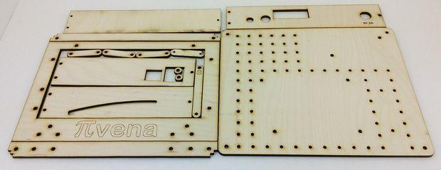 The Pivena laser-cut enclosure unassembled.
