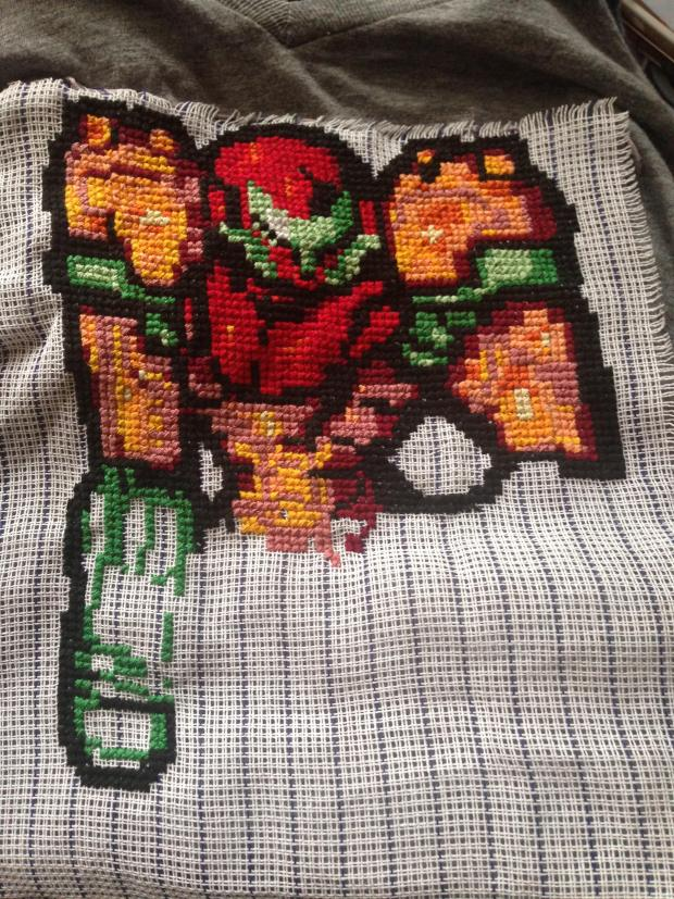 The tricky part of putting a cross-stitched image on a t-shirt is getting rid of the waste canvas, which has to be carefully cut away without damaging the threads.