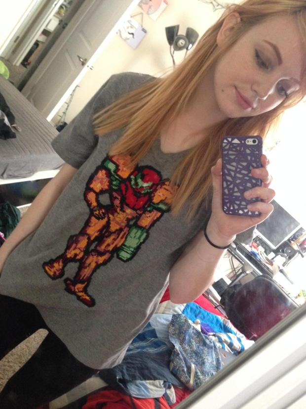 Amythelamey spent 4 weeks (2-hours a day) cross-stitching her Metroid Samus shirt at a resolution of 80 X 140 stiches or pixels.