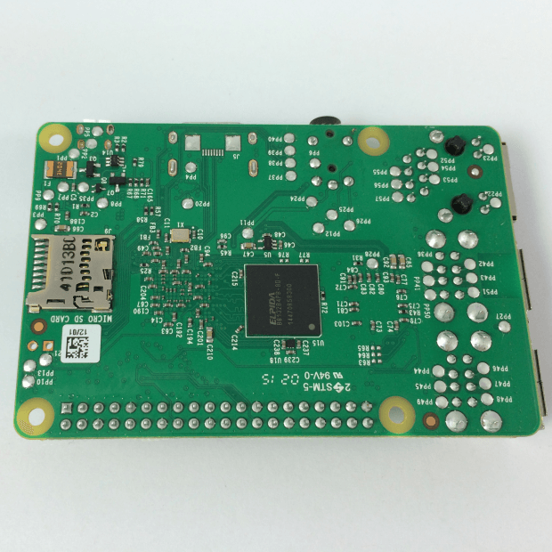 The rear of the new Raspberry Pi 2. The 1GB Micron B8132 SDRAM chip is visible in the center of the board.