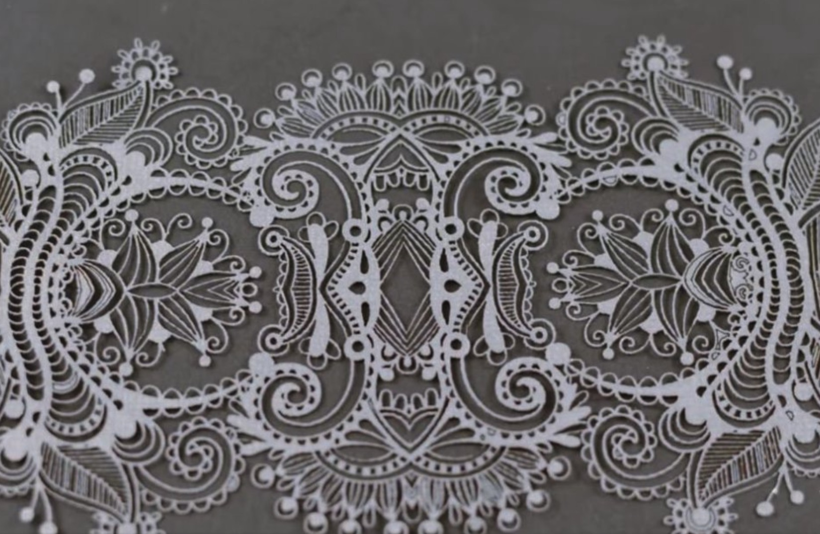 watch-lasers-cut-intricate-lace-designs-paper